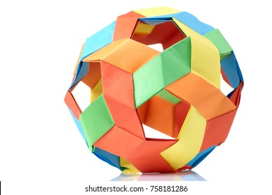 Multicolor sphericalal abstract origami decoration. Difficult level, skills and experience, art of folding paper.