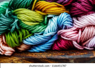 Multicolor threads for embroidery cross-stitch, mulina. Color background.
