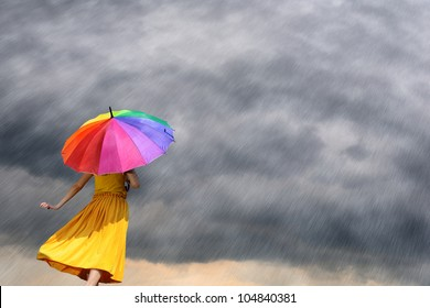 Multicolor umbrella yellow woman against the rain