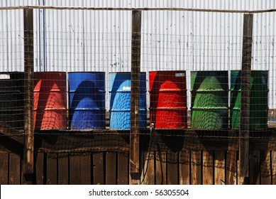 Multicolored 55 gallon barrels on a old loading dock of a oil bulk plant in Klamath Falls