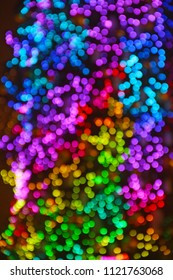 Multicolored abstract bokeh background with new year tree lights