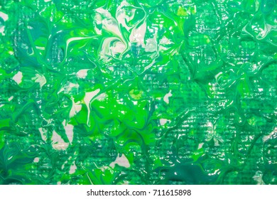 Multicolored abstraction of acrylic. Background. Texture.