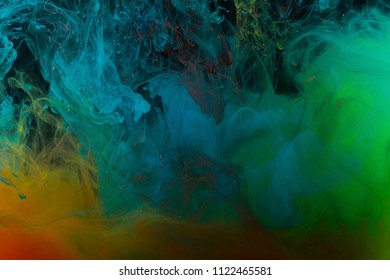 Multicolored abstraction on a black background, studio light