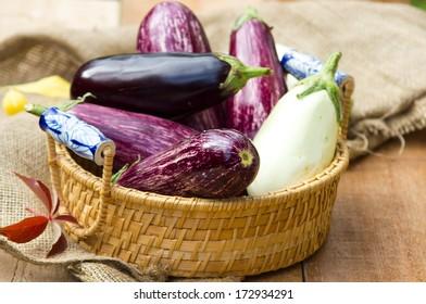 Multicolored aubergines in a basket