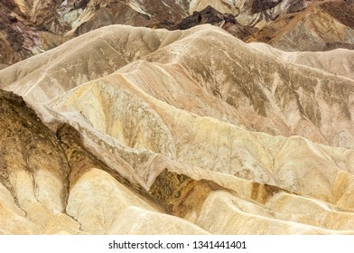 Multicolored background of eroded geological formations in Zabriskie Point, Death Valley national park, California, USA