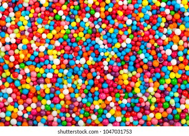 Multicolored background made from sweet sprinkles balls