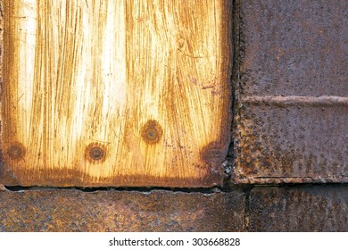 Multicolored background: rusty metal surface with color paint flaking and cracking texture
