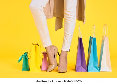 multicolored bags, shopping, fashion background, legs, shoes