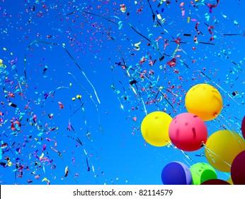 multicolored balloons and confetti in the city festival
