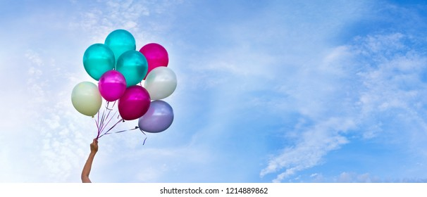 Multicolored balloons, sky background, concept of happy birthday in summer and wedding honeymoon party