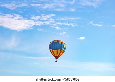 Multicolored balloons in the sky Sky before rain with clouds and sun background