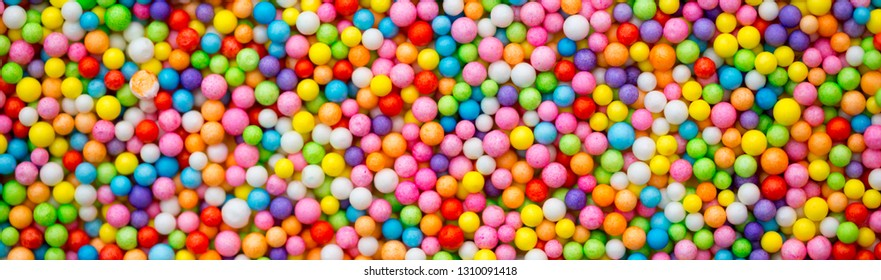 Multicolored balls as background and texture. The concept of celebration and fun. Balls for slime Pool with balls for fun and children's games. long banner