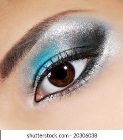 Multicolored beauty make-up on the human eyelid.