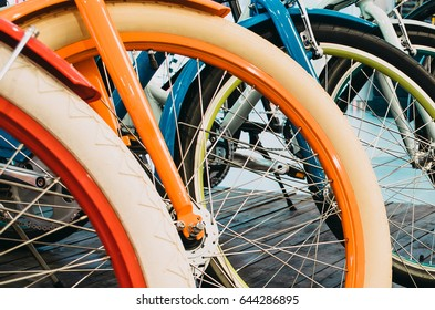 Multicolored bicycle wheels in a row, close-up