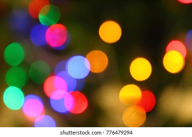 Multicolored blurred background of burning garlands.