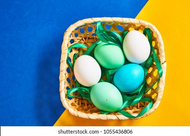 multi-colored boiled eggs in a basket, greens, miscellaneous background...
