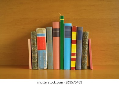 Multicolored books in a row, free copy space