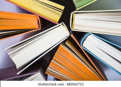 Multicolored books, top view. A lot of books are close-up.