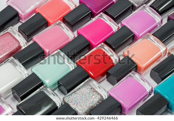 multicolored-bottles-nail-polish-laid-60