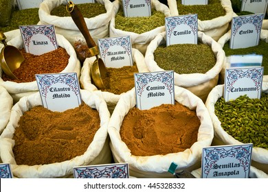 Multi-colored bright spices with plates, on which the written names of herbs and plants.