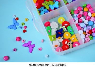 Multicolored buttons to store in box order