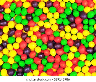 Multicolored candies for use as background. Closeup