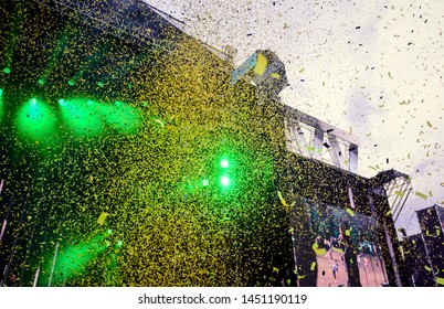 Multicolored candy on the background of green bright spotlights on the festival stage