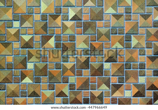 The multi-colored ceramic tiles in the form of a geometric pattern, background, texture
