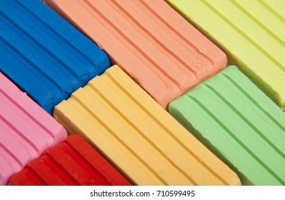 Multi-colored children's plasticine, background. Close up