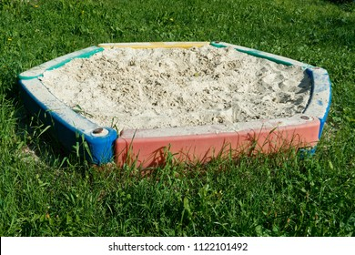 Multicolored Children's sandbox from PVC on a playground