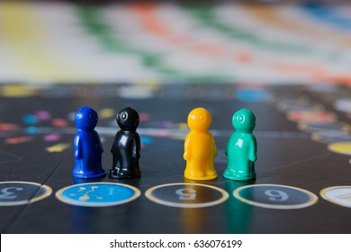 Multi-colored chips for tabletop game in the form of little men.