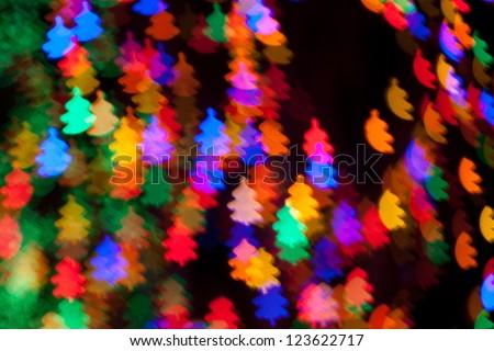 multi colored christmas tree shaped lights bokeh