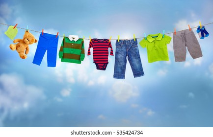 multicolored clothes on clothesline against blue sky