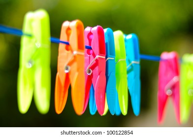 Multicolored clothes pin on rope