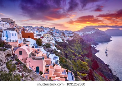 Multicolored clouds of the morning dawn. Fira town on Santorini island, Greece. Incredibly romantic sunrise on Santorini. Oia village in the morning light. Amazing sunset view with white houses.