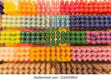 Multicolored colored pencils are placed on the top of the pen - Shutterstock ID 1214193814