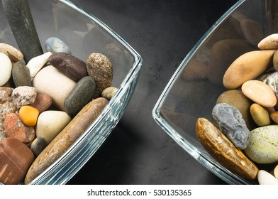 multicolored decorative pebbles in glass containers on a black background