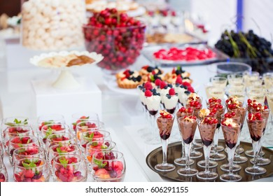Multi-colored dessert decorated with fruit ready to be served in an elegant way