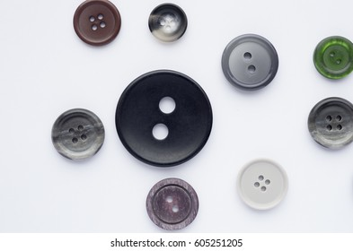 Multicolored different old buttons on a white background