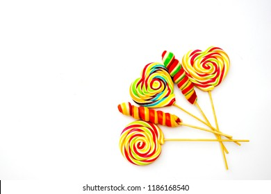 multicolored, different sweets, lollipops on a white background. Copy space. sweets concept