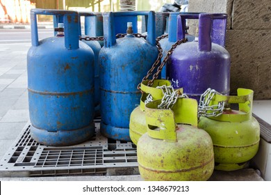 Multi-colored and different-sized gas cylinders on the street.  Bottles with liquefied petroleum gas (LPG), Propane-butane for home use. Jimbaran, Bali.