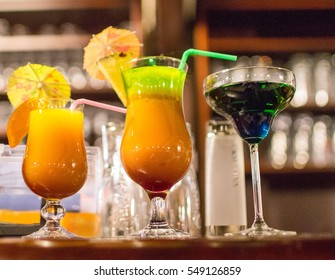 Multi-colored drinks adorned and decorated on the table shoulder