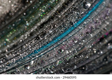 Multi-colored drops on an iridescent surface