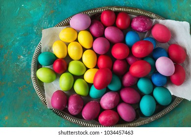 Multicolored Easter eggs on green background.