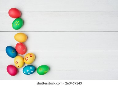multicolored easter eggs on vintage painted wooden background