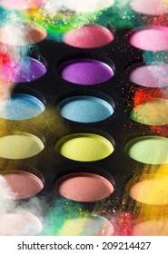 Multicolored eye shadows, close-up.