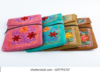 multi-colored fabric handbags, wallets on a white background