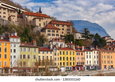 Multi-colored facades of houses on the city embankment. Grenoble. France.