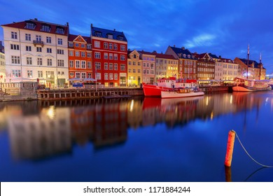 Multicolored facades of old medieval houses and ships along the canal of Nyhavn. Denmark.