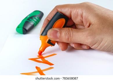 Multicolored felt tip pens on white background